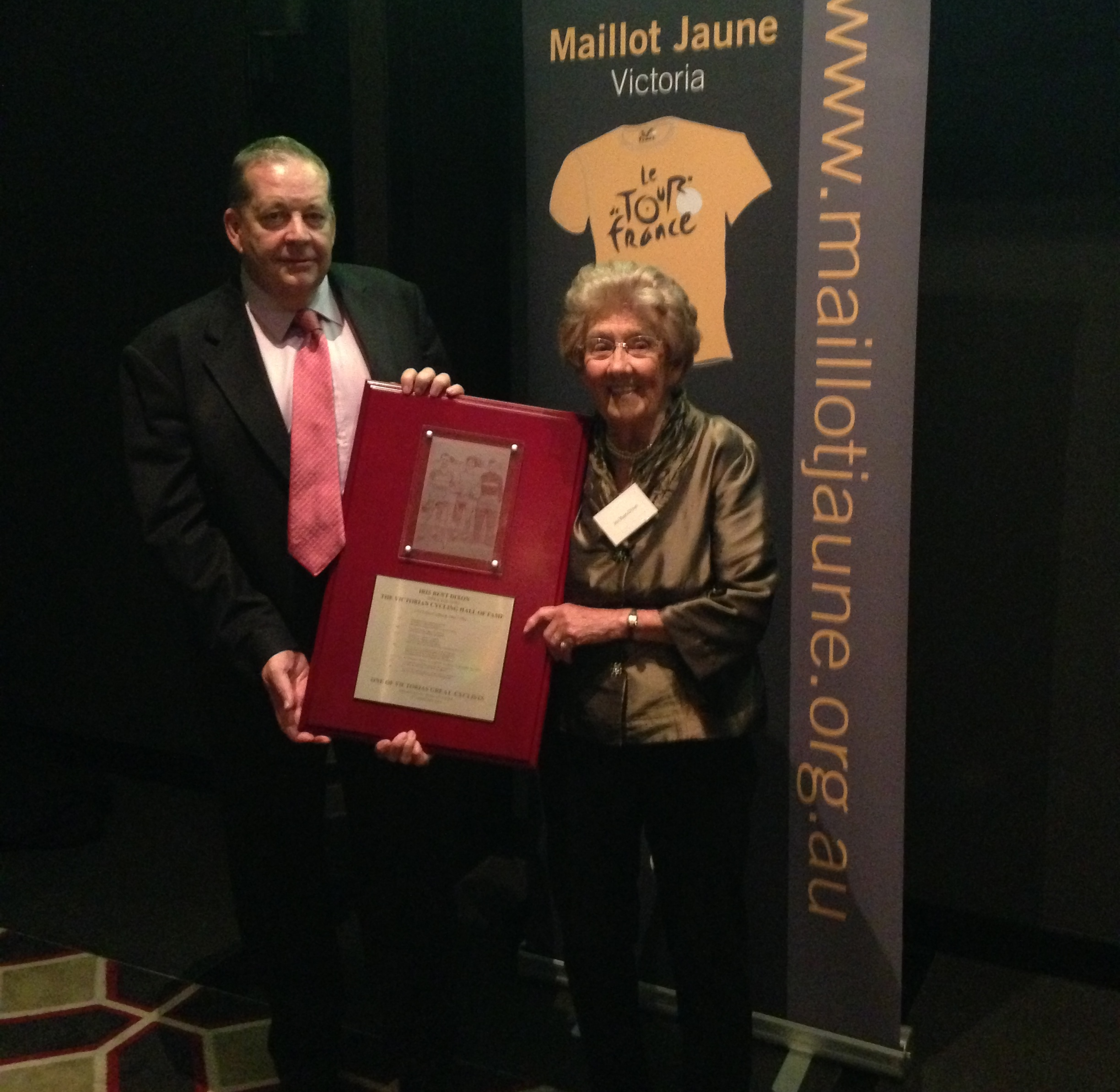 In 2014 Iris was inducted to the Cycling Victoria Hall of Fame. Here with CV President Glen Pearsall