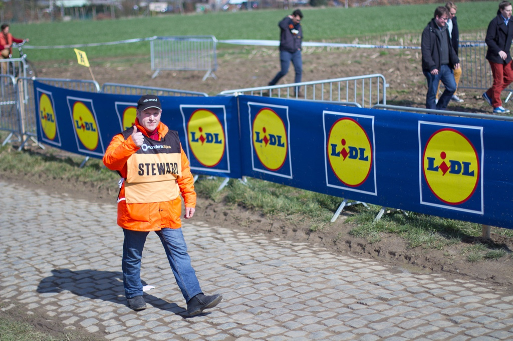 Volunteer stewards and marshals have a huge responsibility to ensure safety. With crowds growing year-on-year, it's a task driven by Flemish passion for their race.