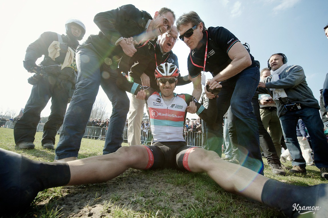 exhausted (& happy) after winning his 3rd Paris-Roubaix