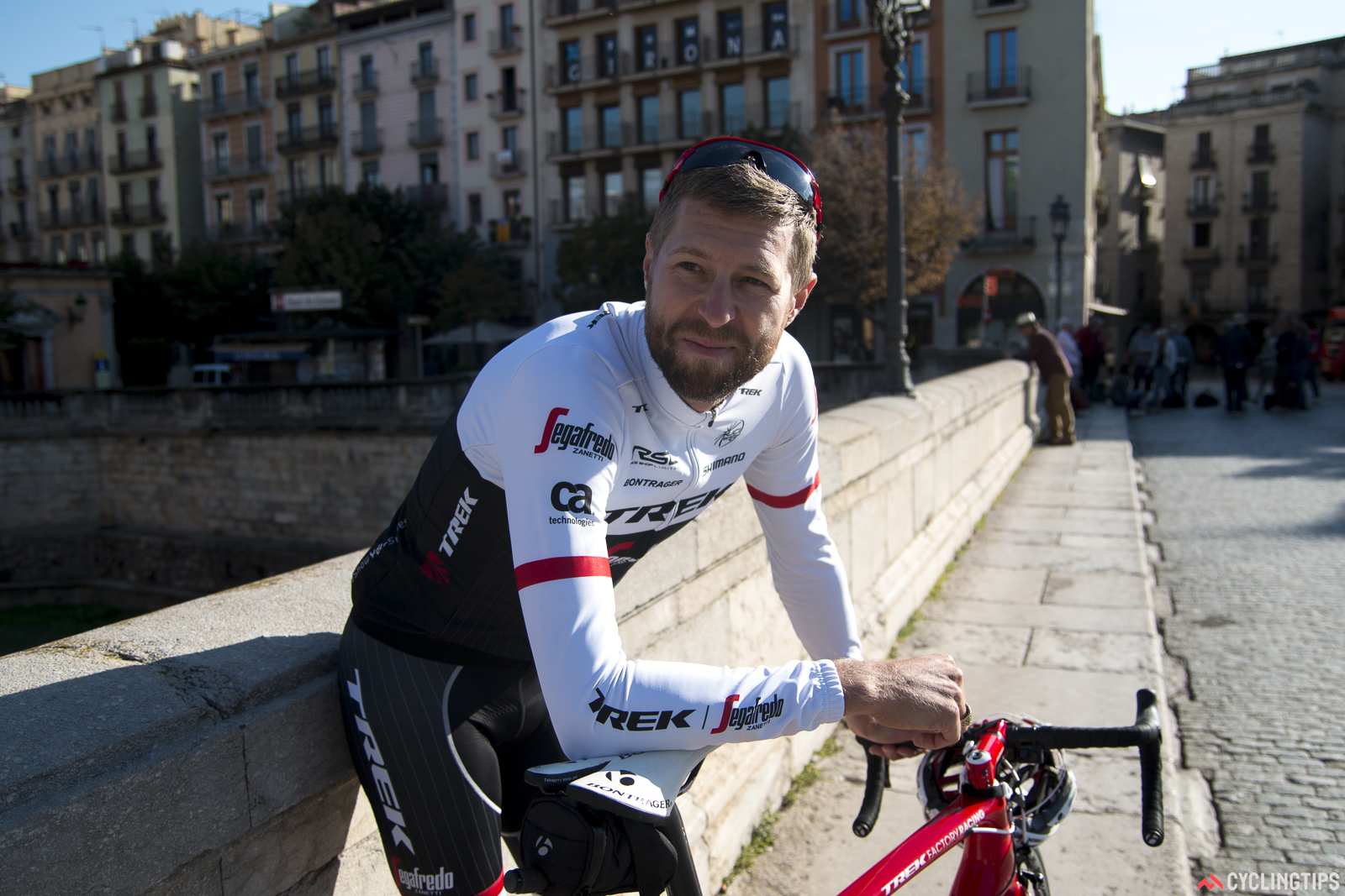 Hesjedal before one of his last training rides in Girona. His apartment is one of those visible behind him, to the left of the Girona sign.