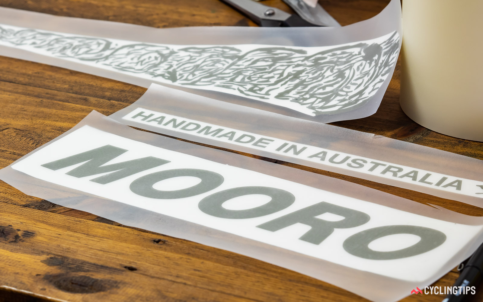 Masks for rendering anodised logos on a titanium frame