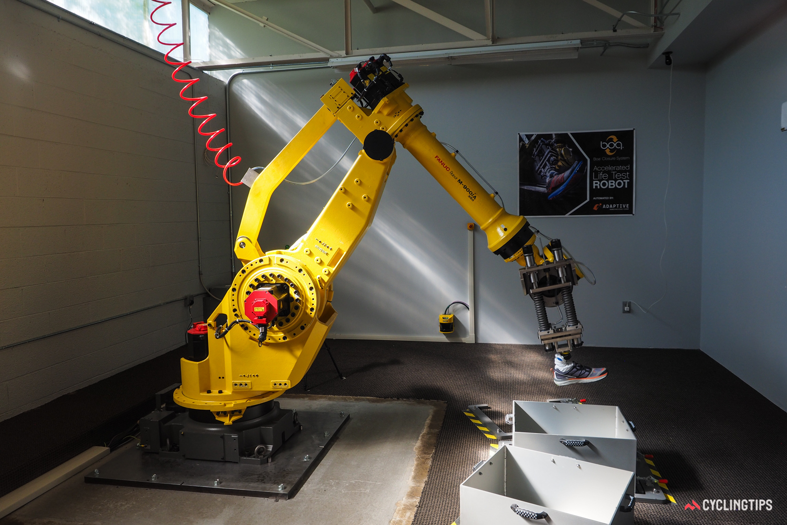 Boa recently purchased an industrial robot, which is used to simulate shoe wear. Test boxes can be filled with different media such as sand, dirt, and concrete.