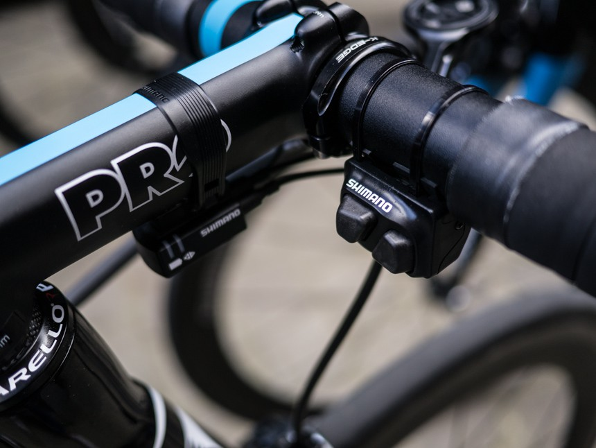 Many of the teams are using Shimano's remote climbing shifters. One button shifts up on the rear derailleur, and the other shifts down. This positioning makes it easier to reach while riding on the cobbles when the rider's hands are positioned on the tops of the handlebars.