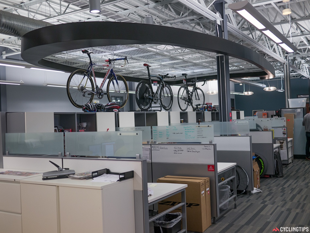 Above the offices hangs a huge outline of a cross section of a Zipp rim