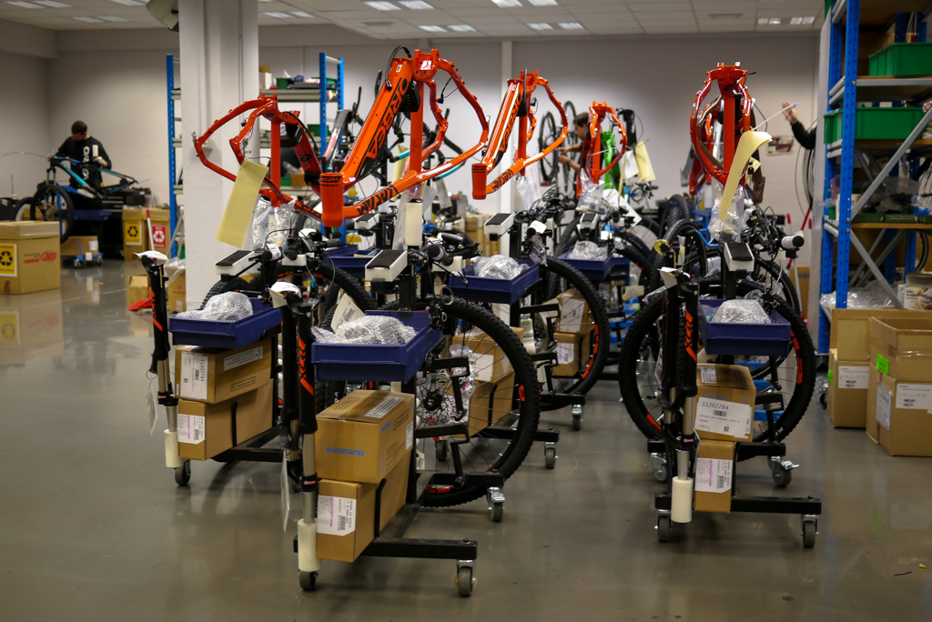 Some of Orbea's mountain bikes wait to be built, prepped and ready on their trollies.
