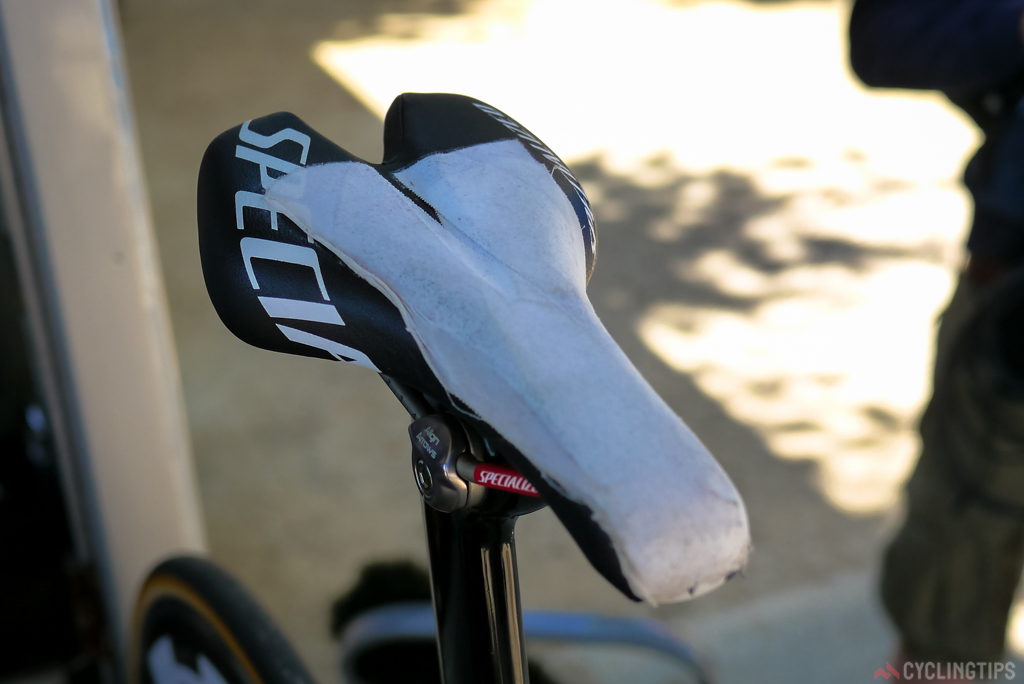 The saddle with what looks like sport tape covering the harsh grip tape like surface.
