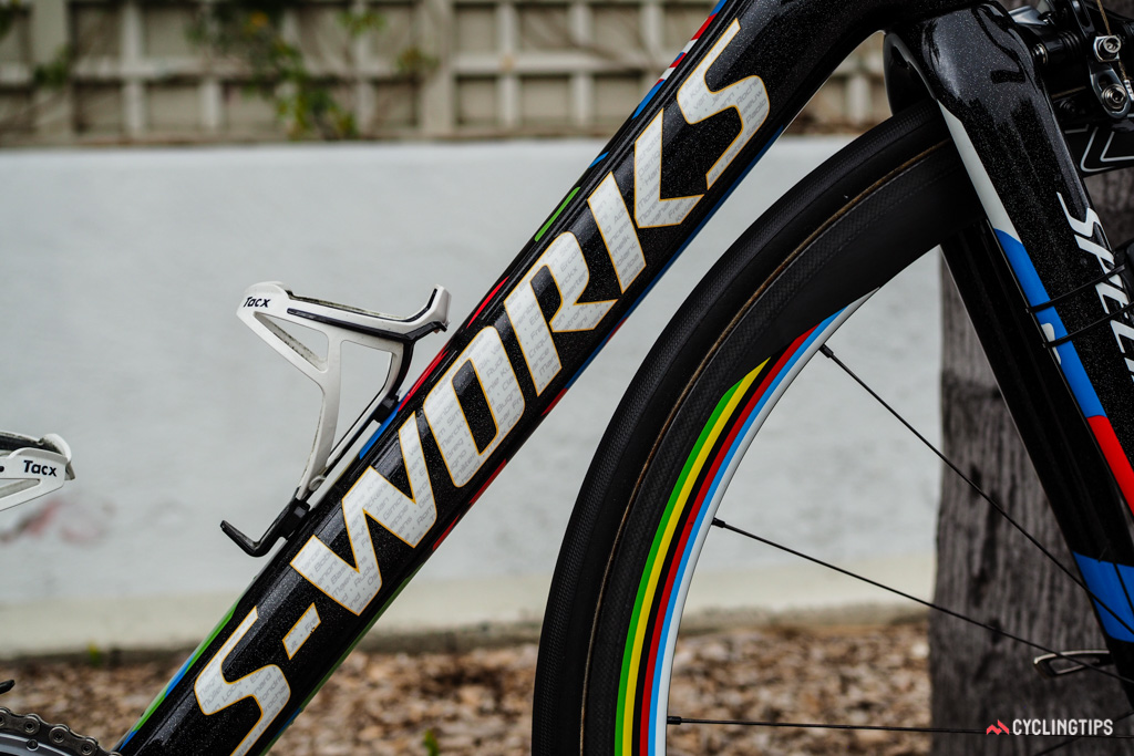 The down tube logo subtly incorporates the names of past champions.
