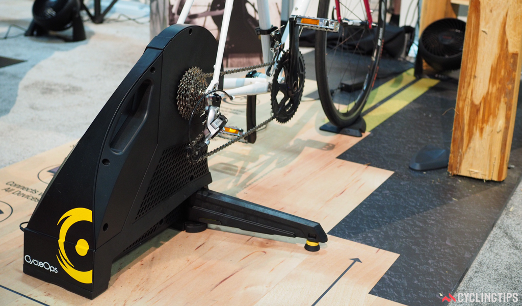 """Powertap's answer to """"connected"""" indoor trainers like the Wahoo KICKR is the new Hammer, built with a hefty 20-pound flywheel, a built-in power meter, computer-adjusted resistance (up to 2000 watts), and both quick-release and thru-axle compatibility."""