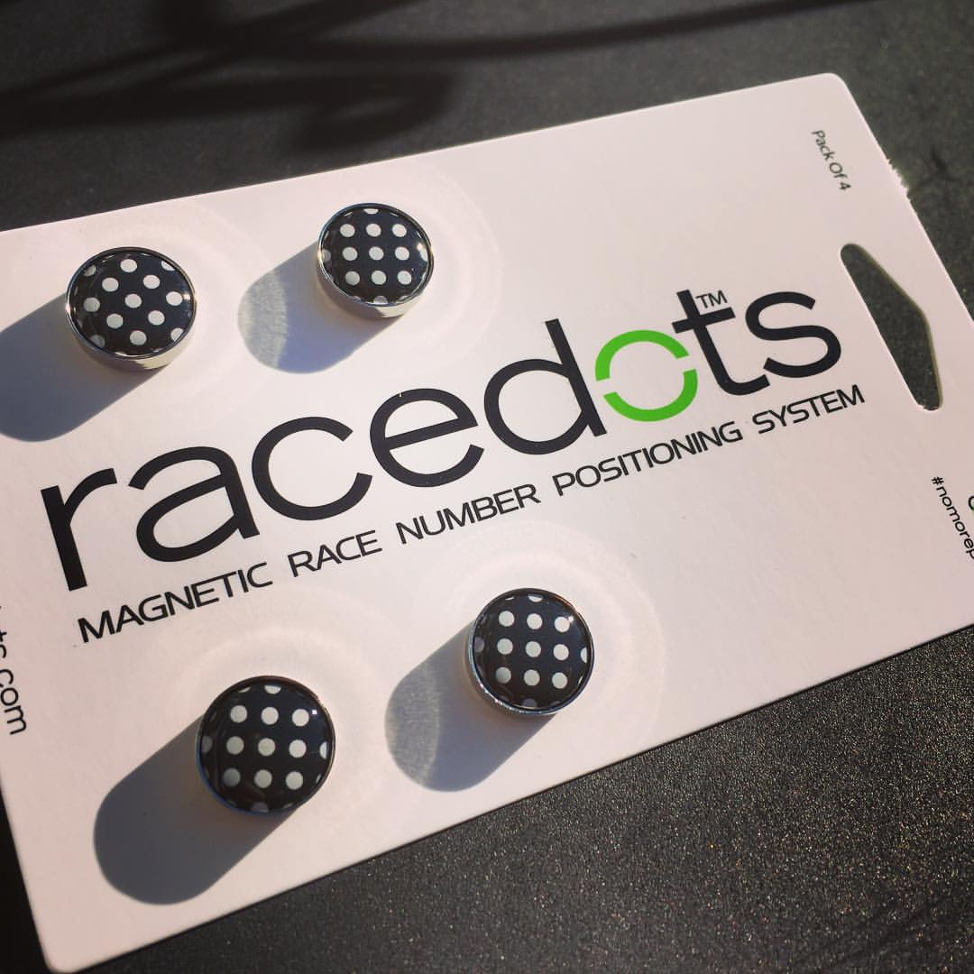 Racedots So we don't want to get a gift of one of these and then have poke a hole through this treasured new kit when we race. That is where race dots come in. http://www.racedots.com/shop/ It's a magnetic system to hold on your race numbers so there is no need to put a safety pin through your treasured jersey when you get that urge to compete. There are plenty of different colours to choose from, even a few nifty new patterns, and the bonus is no more safety pin pricked fingers when you are trying to get the numbers on in a hurry.