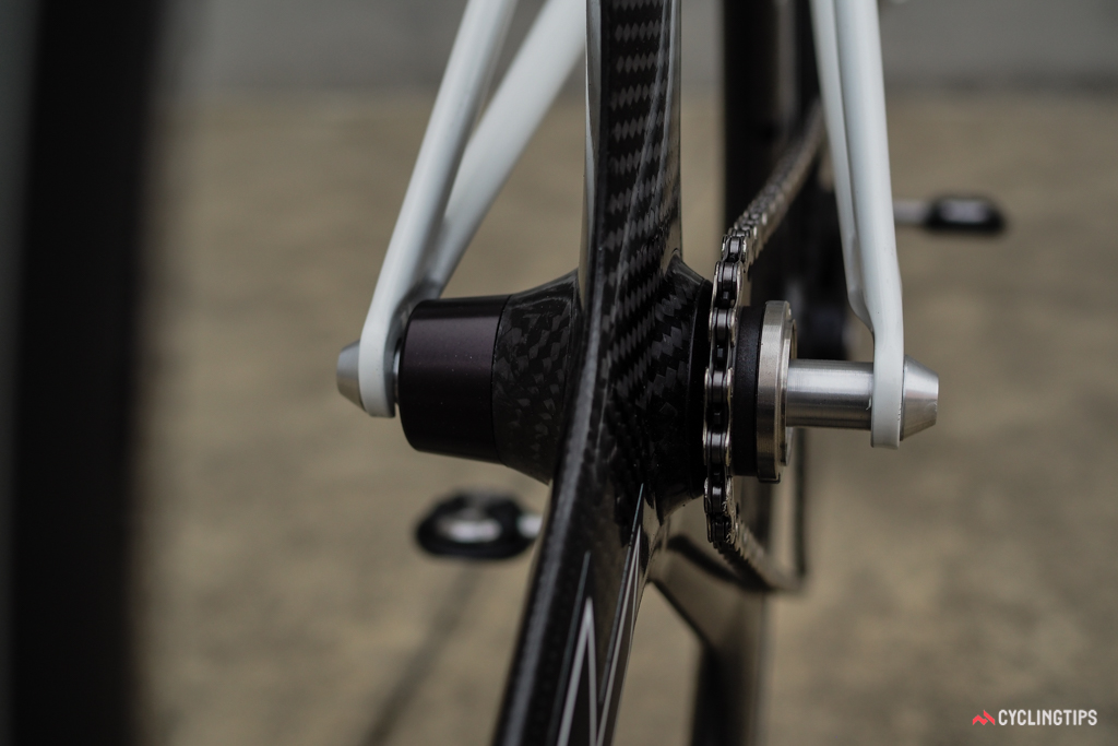 The custom HED three-spoke rear wheel sports 110mm spacing and a cog interface that's set further inboard than usual to maintain a proper chainline.