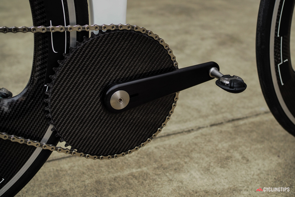 The crankarms were custom machined by a friend in England. The chainring is cut from a solid plate of carbon fiber.