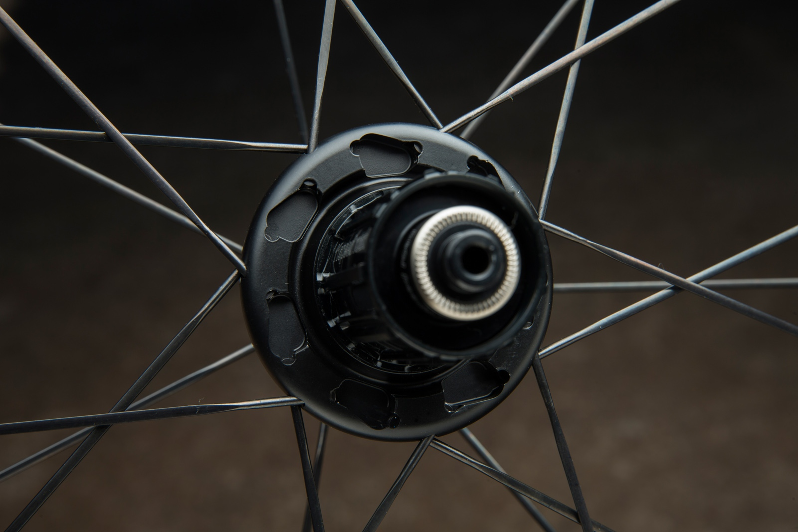 """With Giant's """"Dynamic Balanced Lacing"""" approach on their SLR wheels, opposing spokes have different levels of tension when the wheel is static. But when a rider applies pedaling force as the bike is being ridden, the spoke tensions balance out. Giant says that this improves a wheel's transmission stiffness, which increases efficiency. The rear wheel is  is built with 21 spokes: 14 on the drive side and 7 on the non-drive side."""