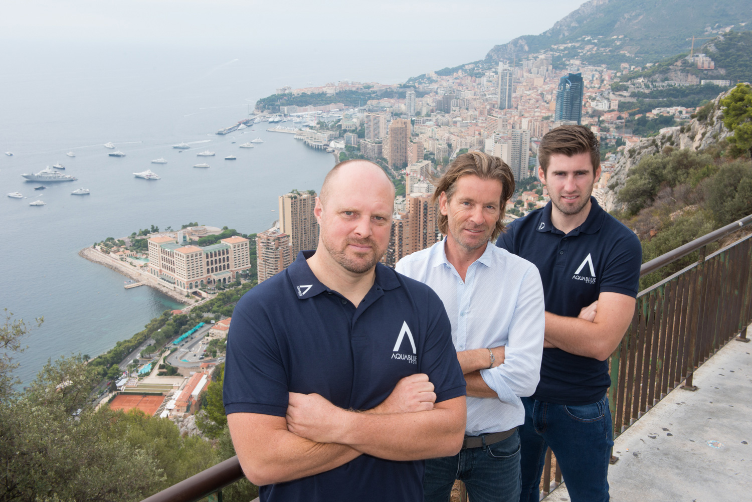 Aqua Blue Sport founder Rick Delaney (centre) with Director of Performance Operations Leigh Bryan (l) and General Manager Stephen Moore.