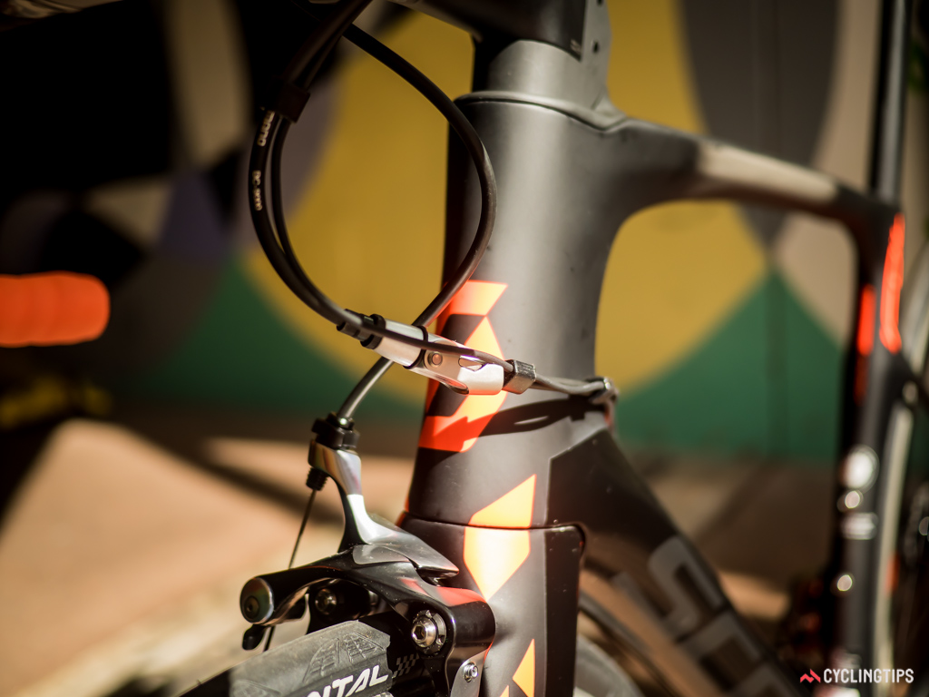 Shimano's in-line quick-release and barrel adjuster eases the hassle associated with a chainstay-mounted brake calliper.