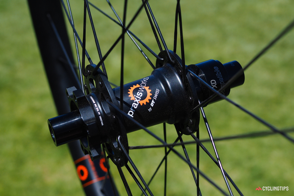 Praxis is definitely prioritizing serviceability on their new wheelsets, which feature proven DT Swiss star ratchet driver internals and a standard six-bolt rotor interface (because you're more likely to have a T25 Torx wrench on hand than a lockring tool).