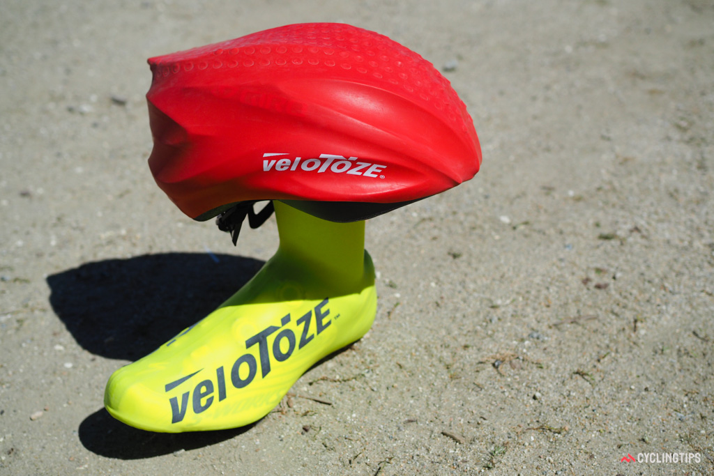 VeloToze follows up on the success of their simple latex rubber shoe covers with a new helmet cover made of the same material. The sample shown here is a prototype; production versions will extend further to better cover the sides.