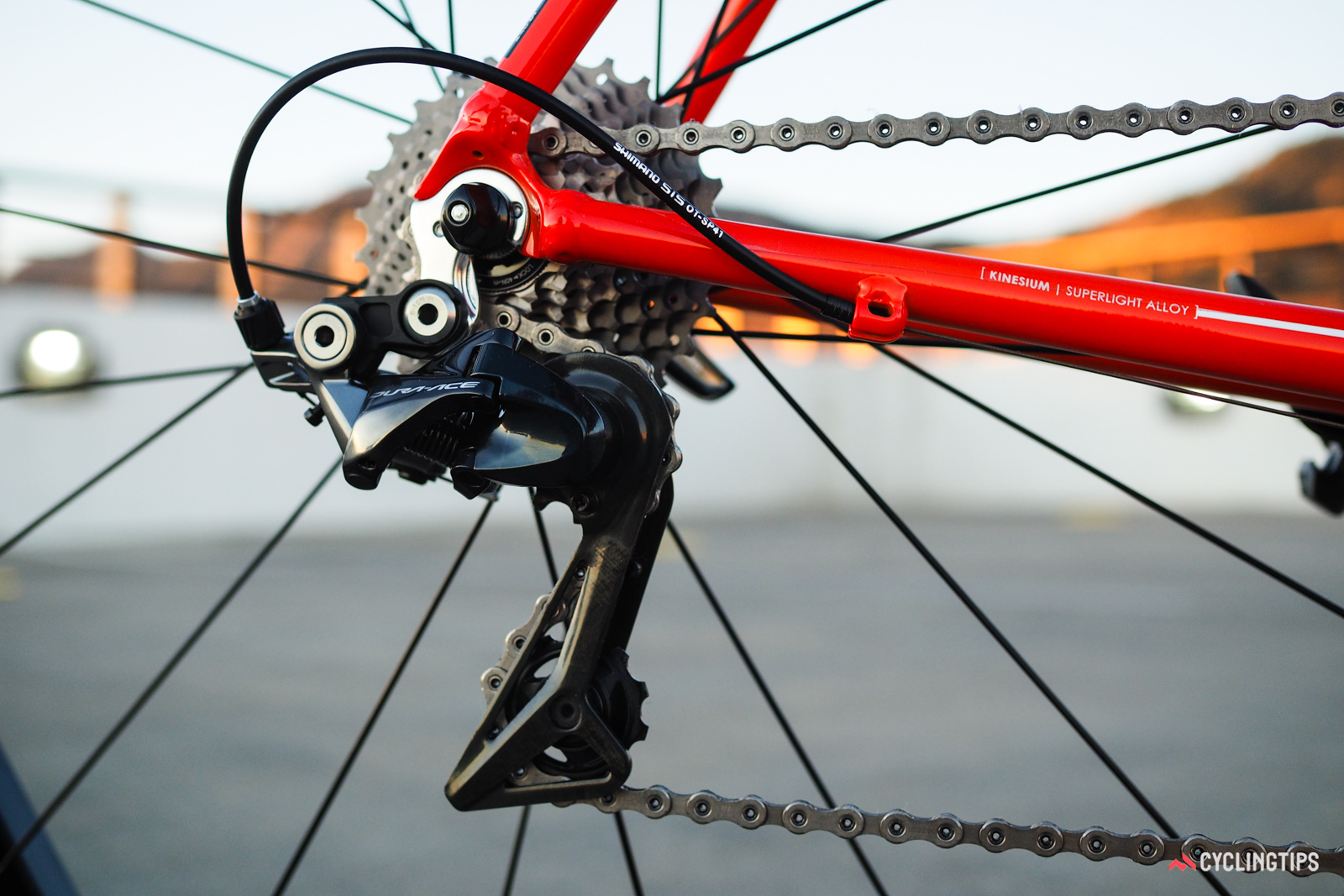 The upper pulley is concentric with the cage pivot, thus maintaining a consistent chain gap regardless of chainring or rear sprocket position. The upper pivot is no longer spring loaded, either, switching to an adjustable stationary position similar to what Shimano does on its mountain bike rear derailleurs.