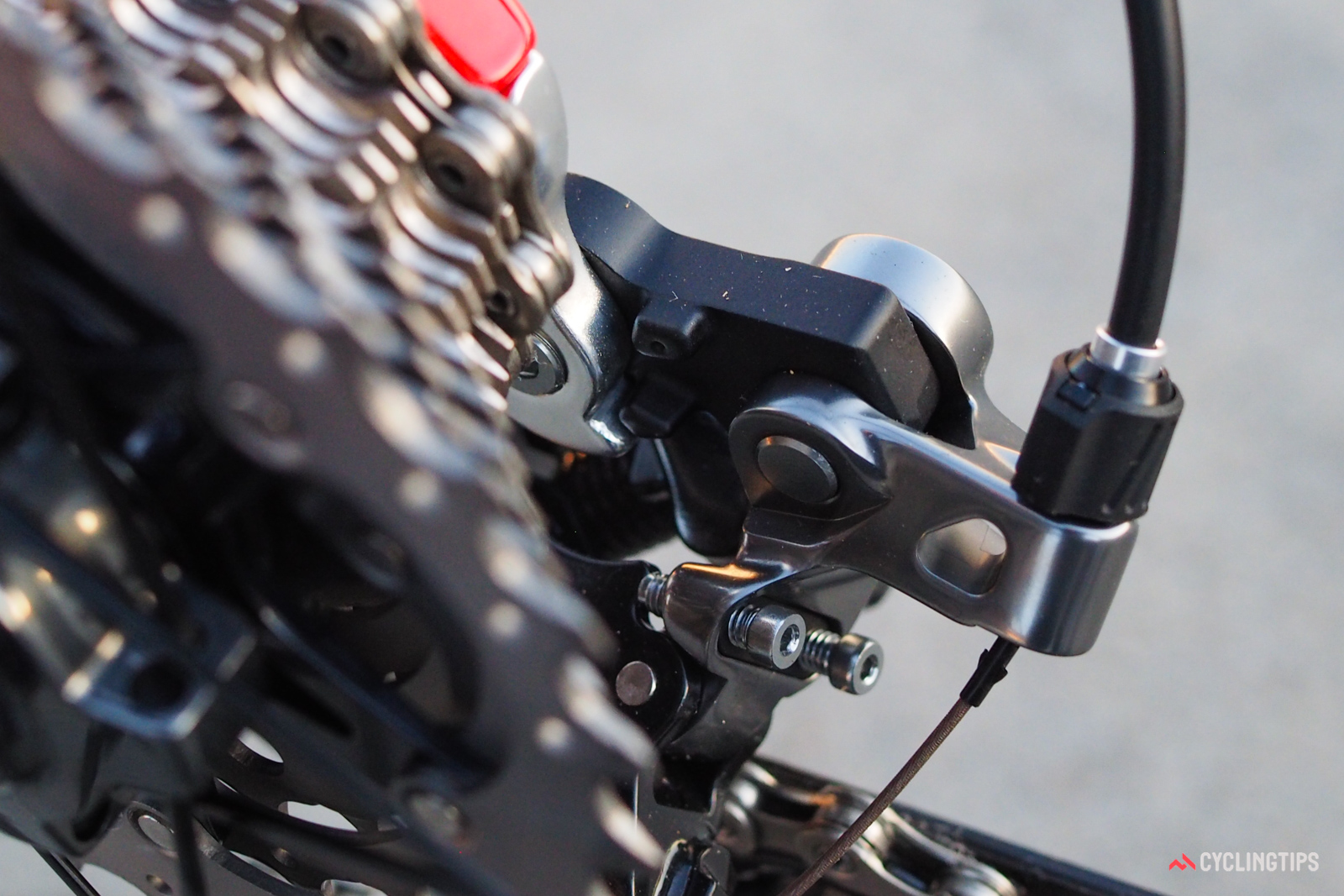 It probably won't be long until frame manufacturers begin to offer direct-mount hangers to work specifically with Shimano's latest rear derailleurs. Eliminating this intermediate link (the one in black) and attaching the derailleur body directly to an extended hanger would not only speed up wheel changes, but would also increase system rigidity.