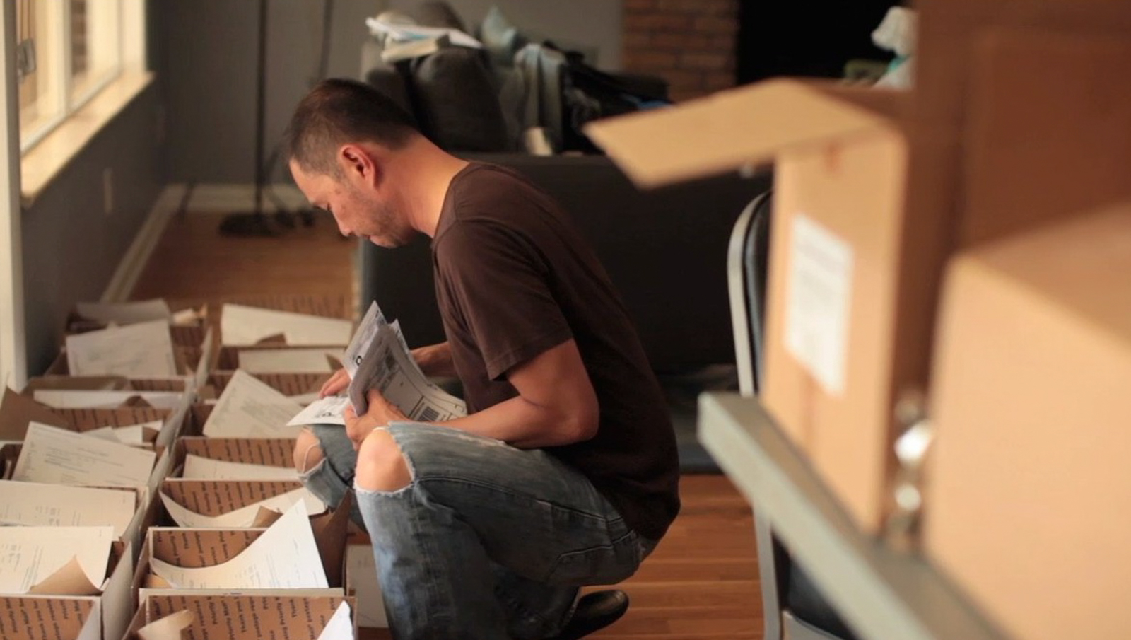 As with many startups, the founders were busy early on with all sorts of tasks. Here, Allen Lim is shown filling orders himself. Photo: Jamie Kripke.
