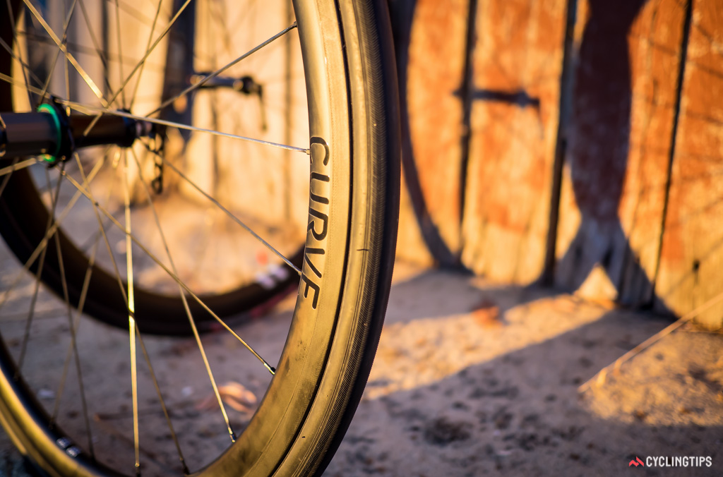 Curve's 38mm carbon clincher rims were laced to the hubs with Sapim CX-Ray spokes.