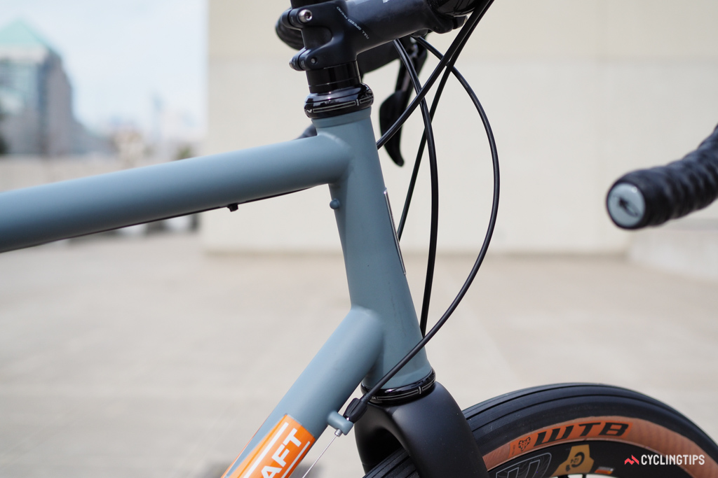 The head tube is gracefully tapered to match the tapered fork steerer. The external cups add a bit of a classic touch.