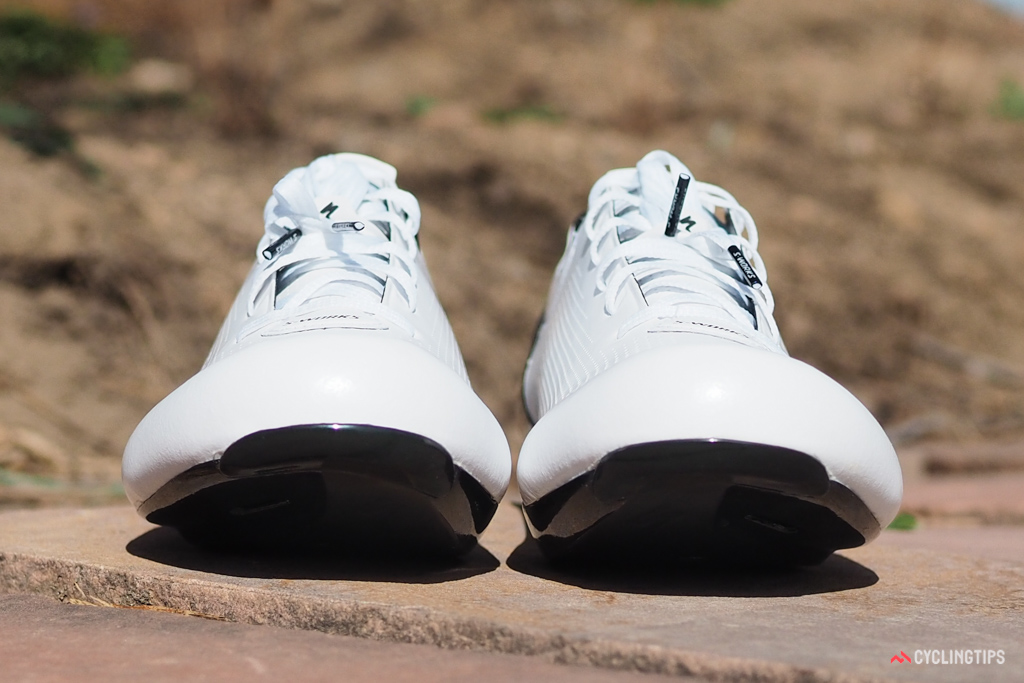 The uppers flare outward where they meet the carbon sole to better mimic the shape of your feet.