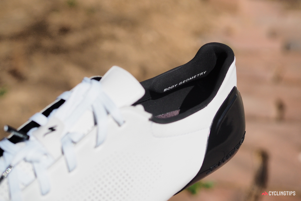 Heel hold is further enhanced by the shaped padding and grippy fabric inside the heel cup.