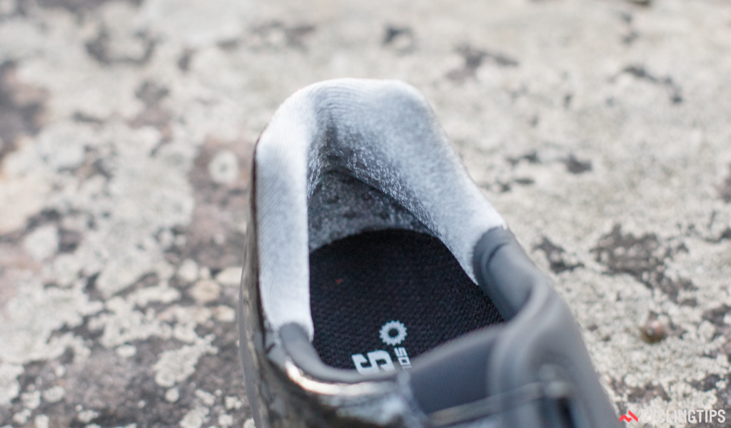 Your heel is locked in with a combination of a deep heel cup, padding, silicone grippers and a Velcro-like material.