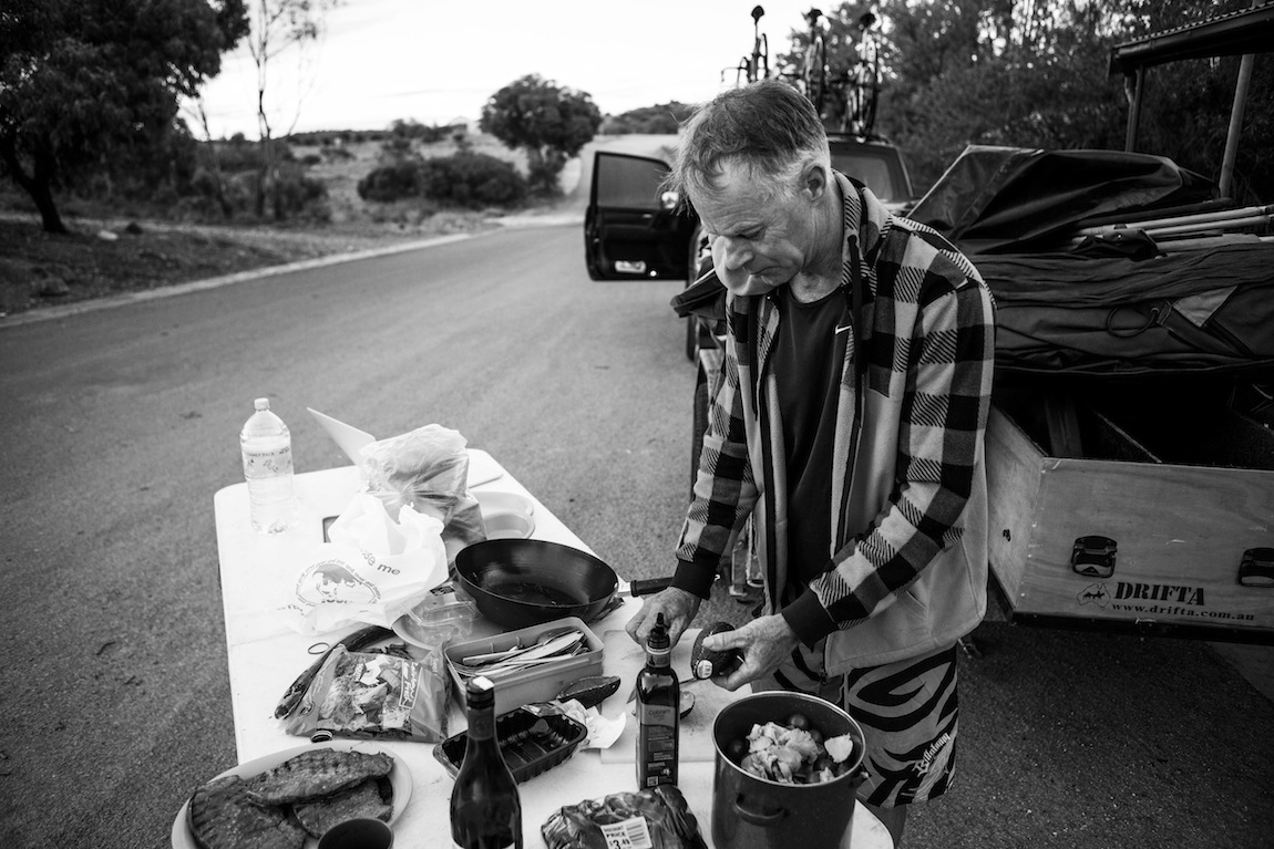 Chris Varcoe has lived a thousand lives. Corporate head hunter, youth worker, and life coach to name a few. He's sung hymns with both Peter Garrett and Tony Abbott. He's ridden the European alps. He's built and then slept in an igloo. He also owns a lotus  Espirit V8. Every morning he prayed for our safety and good conditions. And they came. But Chris Varcoe had never listened to Rap music, drunk a cocktail or had a bourbon  before he came on the road with us. It's fair to say we exchanged ideas about the  world. Chris drove, massaged and maintained us as we pushed across the country. He never complained and he always asked how we felt. One lesson he gave that really  stuck in our minds is that a skate board, an ocky strap, a car and a set of balls can  have you travelling quite quickly down Barndioota Rd in the South Australian outback.