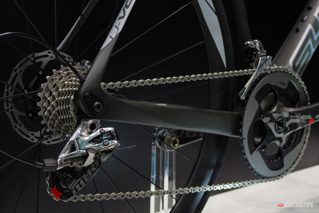 The exit point for the internally routed rear derailleur line keeps it up and out of the way of the wheel.
