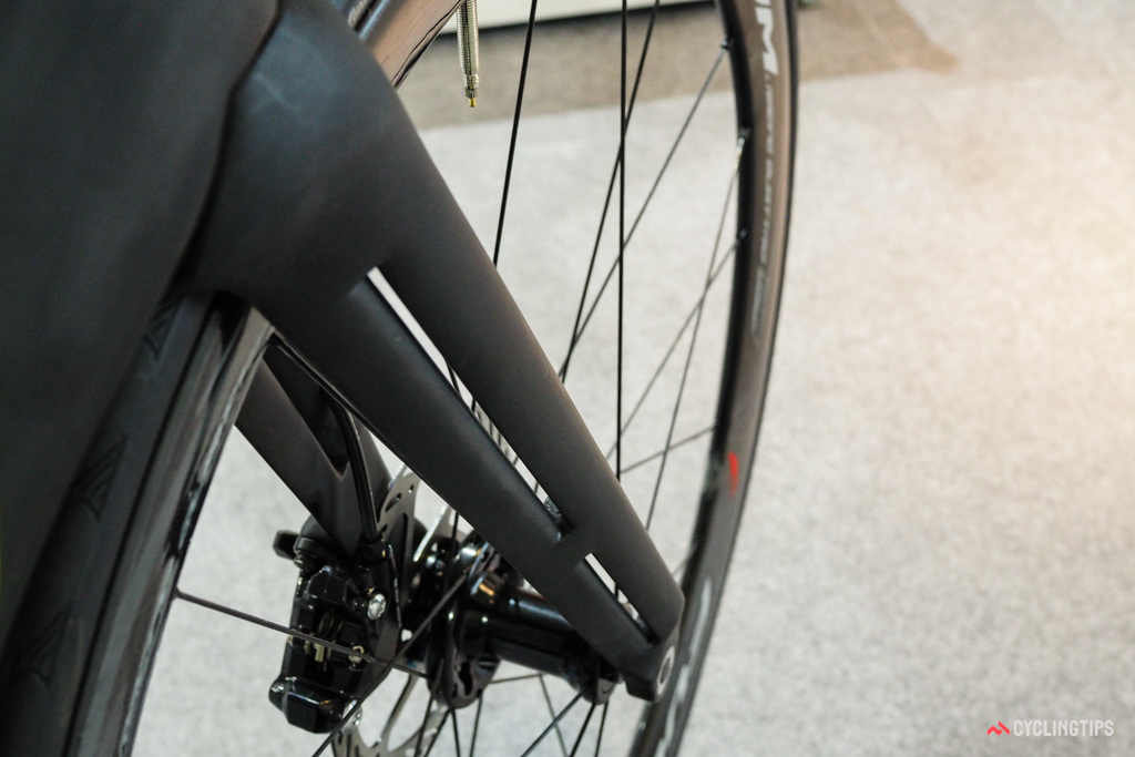 The split fork blades supposedly reduce aerodynamic drag by pulling air out and away from the churning front wheel.