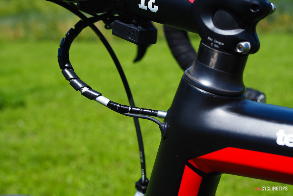 Although the head tube entry point for the rear brake cable looks clean, it requires a pretty tight bend. A short section of segmented aluminum housing placed inline with the standard housing does the trick.