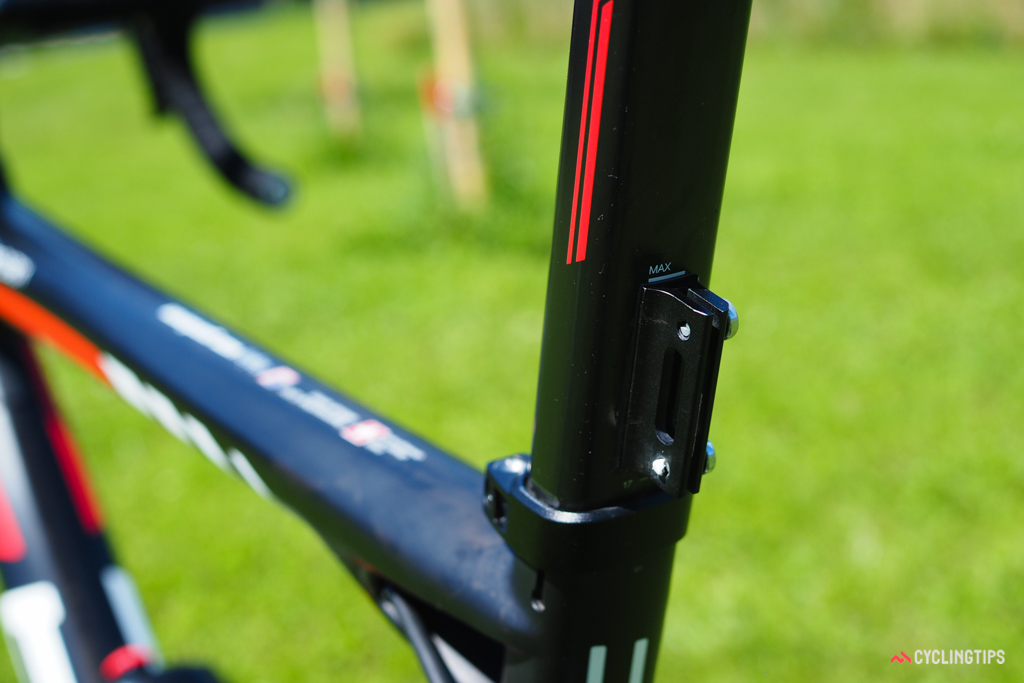 These neat aluminum number plate holders are bonded to the back of the seatposts on the BMC team bikes.