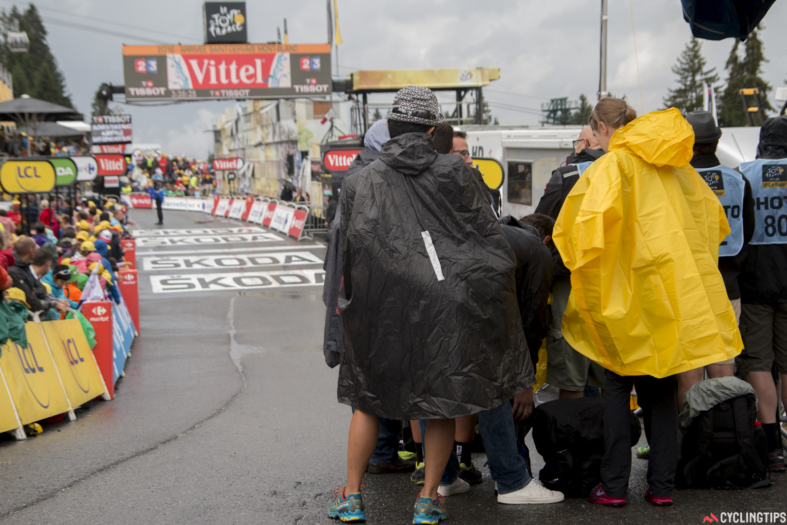 Photographer Ashley Gruber (in yellow) awaits the riders at the finish of stage 19 of the 2016 Tour de France.