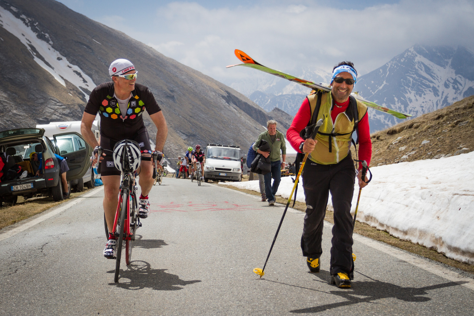 """Alain Rumpf, Switzerland. """"Stage 19 of the 2016 Giro went over the Colle dell'Agnello. Although we were in late May, there was still a lot of snow on this giant of the Alps (2'744 m). Enough for some late season ski touring... I love this shot because it shows two happy dudes enjoying the mountains, each one in his own way. I don't know which one I was more jealous of on that day."""" DSLR. @aswisswithapulse"""