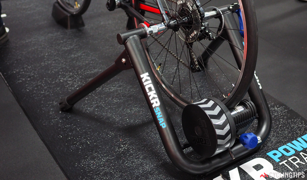 The Wahoo Fitness KICKR Snap stationary trainer features an electronically controlled resistance unit like the original KICKR for a realistic feel, quiet running, and easy compatibility with online environments such as Zwift and TrainerRoad. The convention tire-driven design and simplified frame bring the price down considerably, however, to a more palatable US$699.