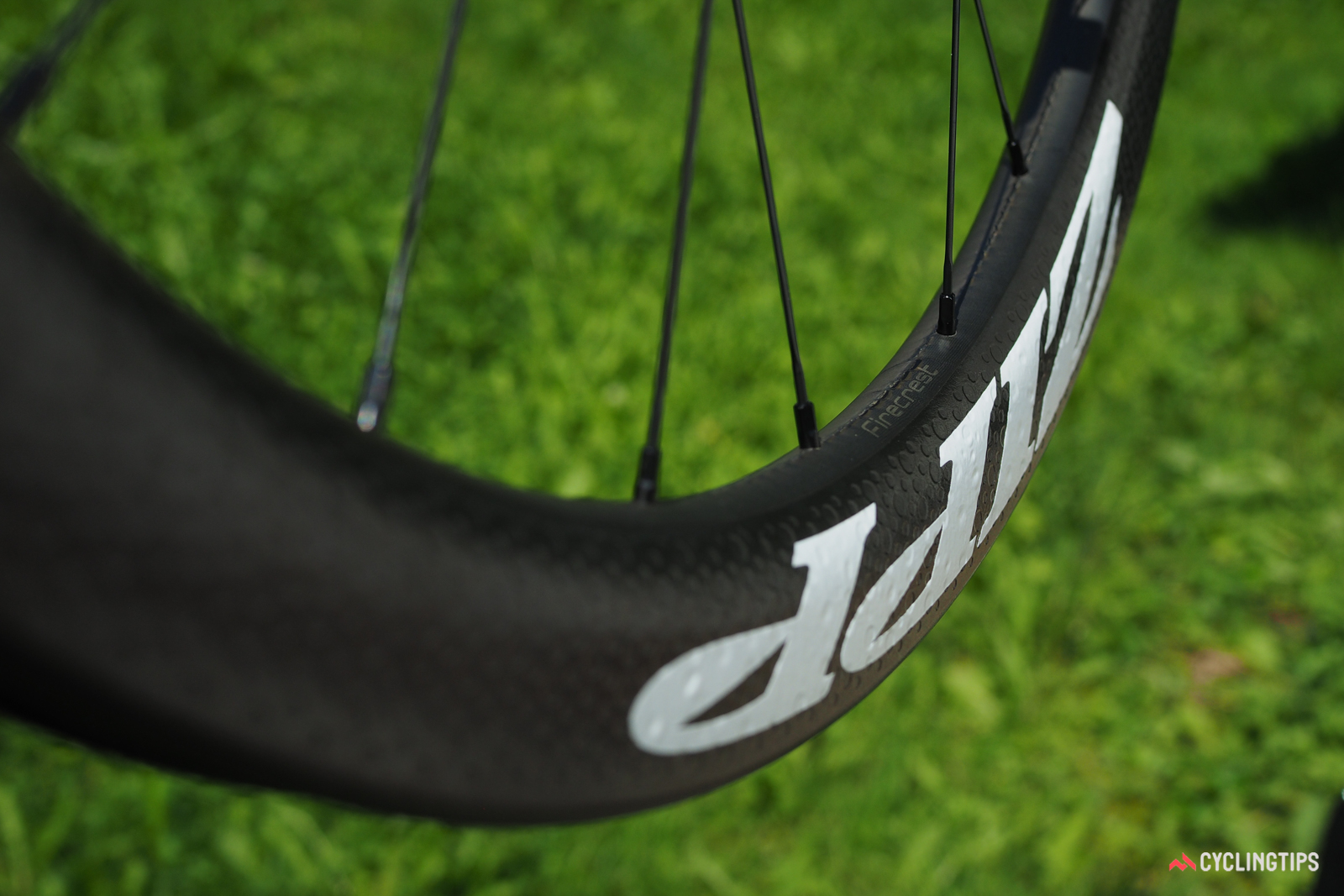 Disc-specific rims offer more flexibility in terms of shaping than ones designed for rim brakes. In the case of the new Zipp 303 Firecrest carbon clincher, the fatter outer edge makes for a smoother transition to the tire. Note how the dimples also fill in the space where a brake track would normally go, too.