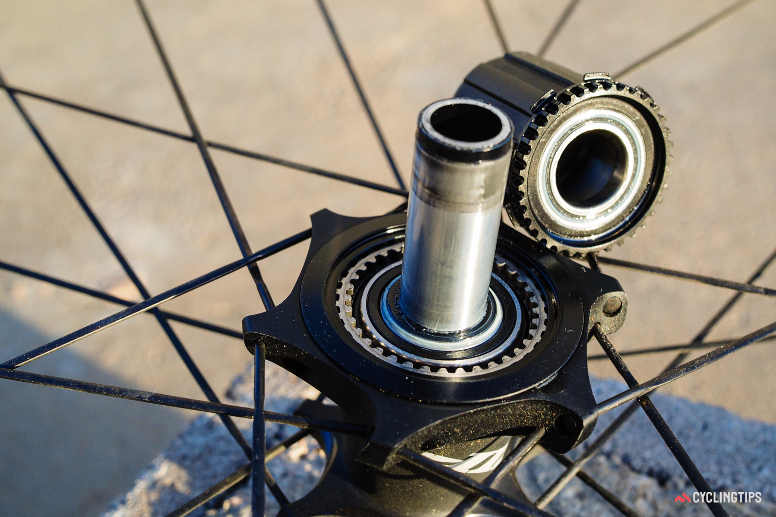 The Cognition rear hub's Axial Clutch driver mechanism looks unusual, but in essence is very similar to DT Swiss's long-running Star Ratchet design, only with magnets in lieu of conventional steel springs. Freehubs are interchangeable between SRAM/Shimano 11spd, Campagnolo 11spd, and SRAM XD standards.