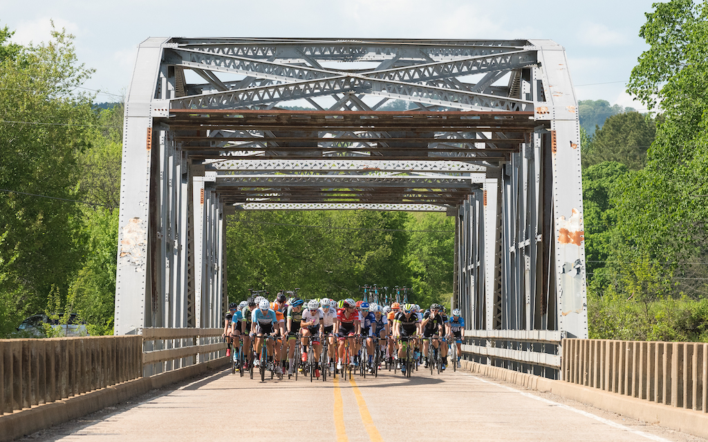 The field rolled across a steel girder bridge in the Arkansas countryside while a breakaway worked hard to establish a lead that eventually grew to six minutes. Photo: Dejan Smaic.