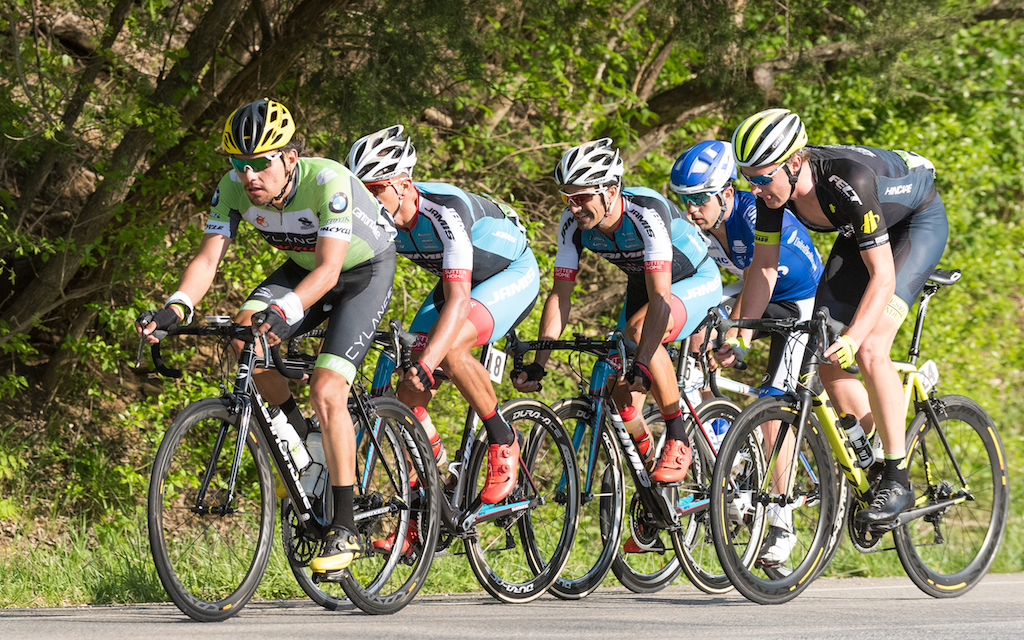 The break felt the pressure from a chase group and a charging field as Stage 2 wound down. In this photo, Andres Diaz (Cylance) worked on the front while Jamis riders Luis Amaran and Sebastian Haedo rode in the draft. Photo: Dejan Smaic.