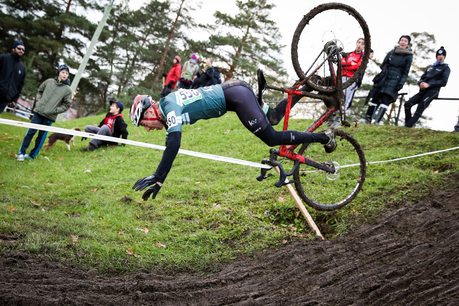 """Paul Schwartz, Canada. """"At the 2015 Quebec Provincial Cyclocross Championships, this rider went a bit too far off the line while trying to avoid the muddy and rutted descent, only to hit a hole, sending him flying. Amazingly, he didn't break body or bike and actually finished the race. I've purposefully worked on keeping the camera shooting during crashes over the past few years, it's difficult not to flinch, but it's yielded some epic shots -- a good skill to hone!"""" DSLR. @pss999"""