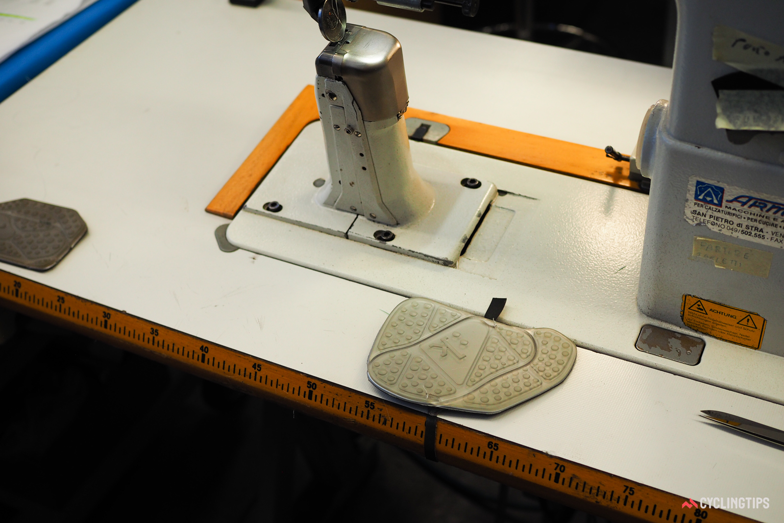 A pair of gel armrest pads sees some alternate duty at the sewing stations.