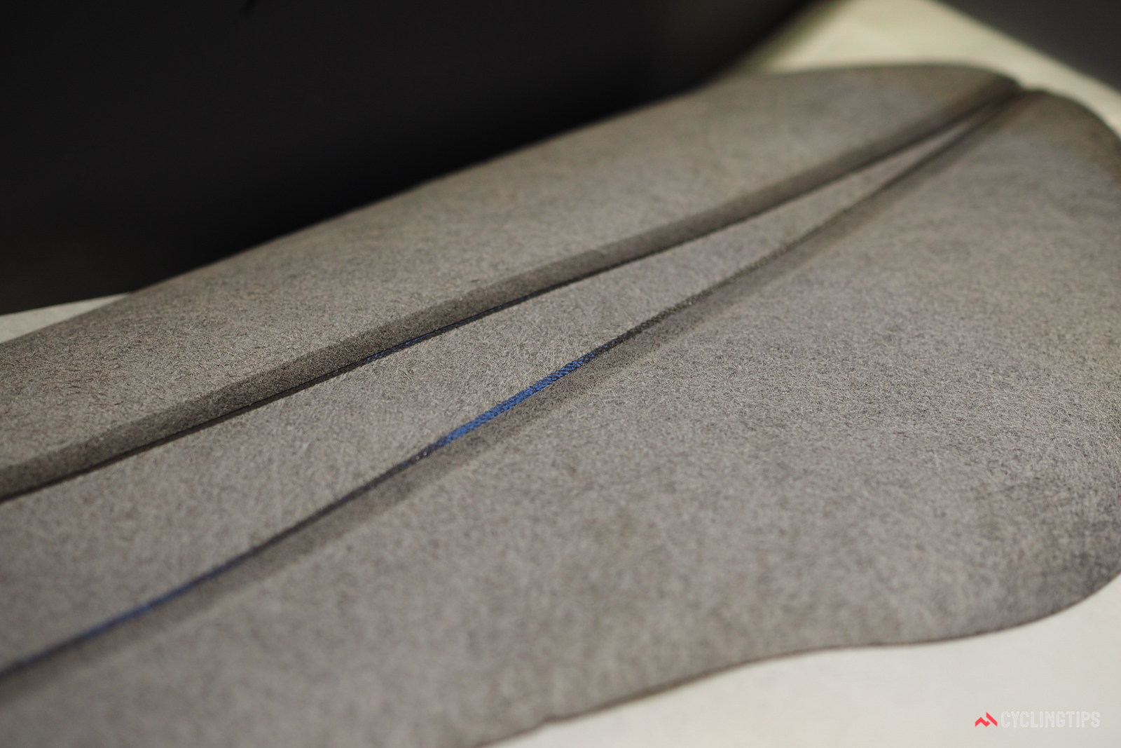 Bonded seams are first shaved down so as to maintain a constant thickness in the finished part.
