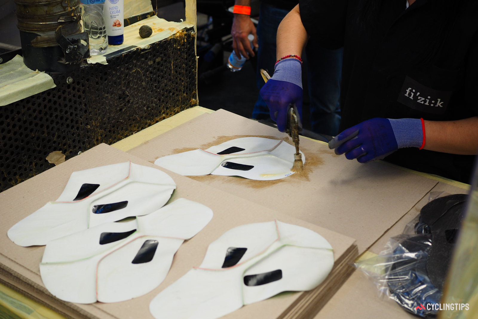 Glue is applied to the underside of the covers, too. The adhesives used are essentially contact cements, not unlike tubular glue.