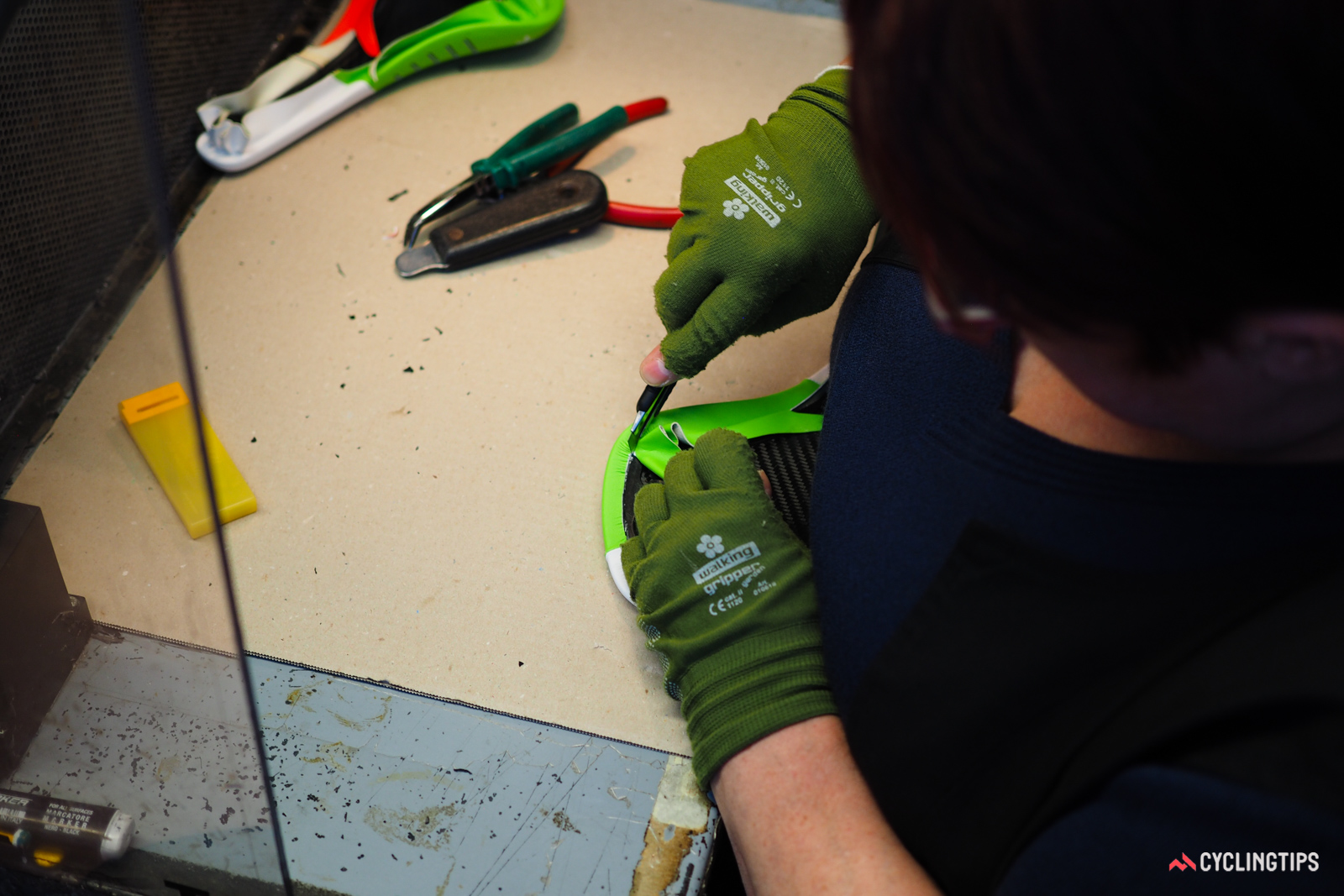 Excess material is trimmed by hand.