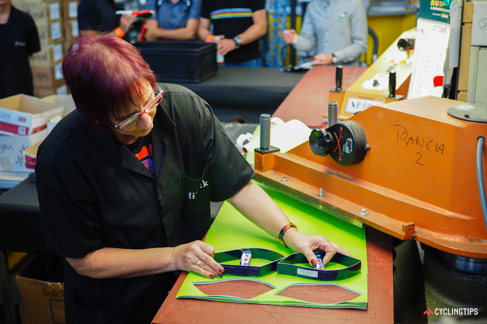 Dies are positioned by hand, using nothing but experience to help maximize the fabric yield.