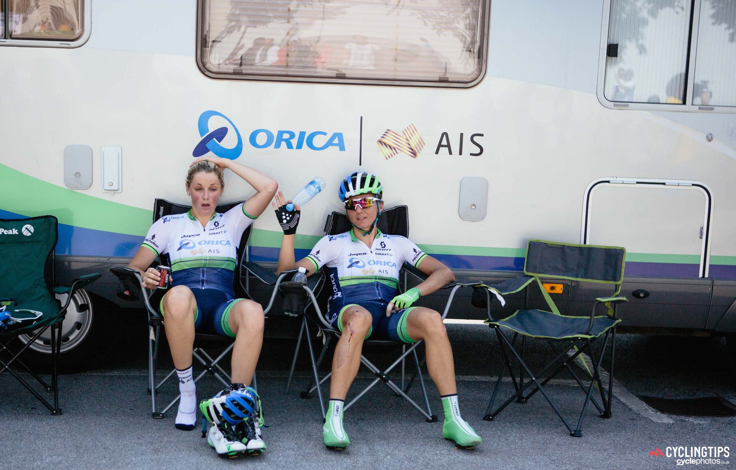The heat during the opening road stages was as much a shock to the system as the speed. Orica-AIS teammates Macey Stewart and Katrin Garfoot recover post-race.