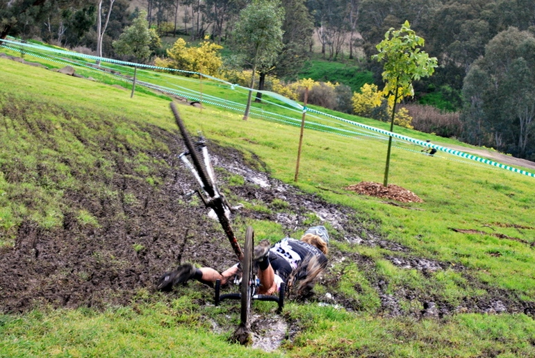 A rider tastes the mud on one of the slipperiest parts of the course.