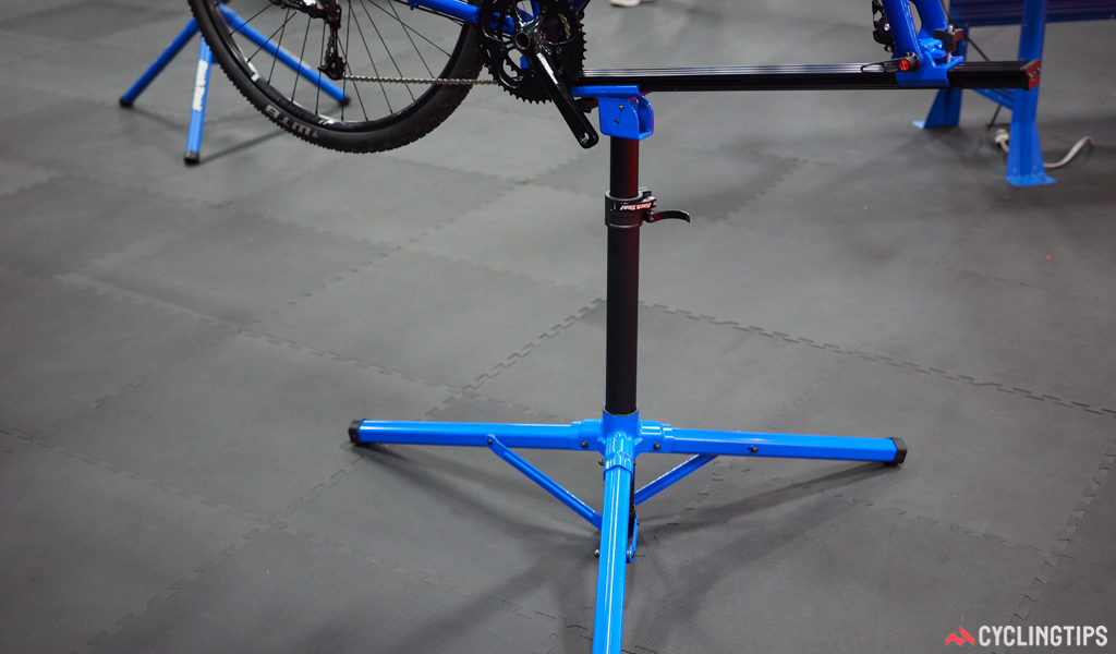Park Tool's new Euro-style repair stand features articulating legs, a neat two-stage clamp with independent height and rotation adjustments, and a neat clamp that easily accommodates both quick-release and thru-axle bikes.