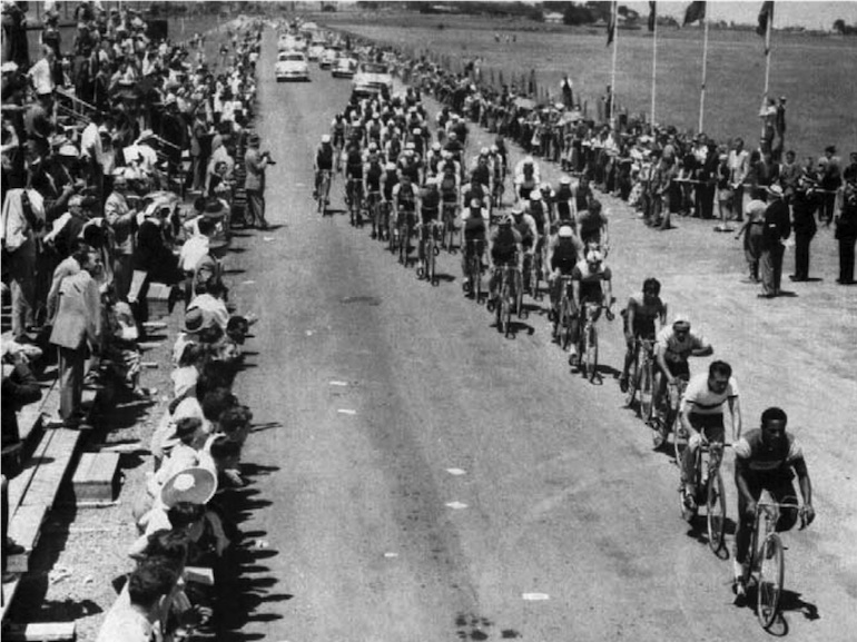 Passing the spectator stands during the 1956 Olympic road race (Image: official race report).